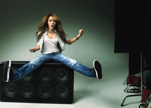 0401-miley-cyrus-on-speakers_aw